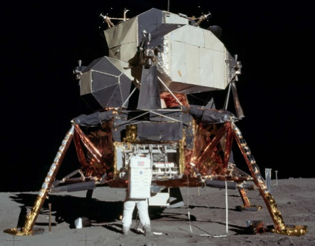 photo of lunar landing module with astronaut
