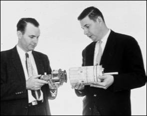 photo of Richter holding the low powered transmitter and subcarrier oscillators designed for Explorer III